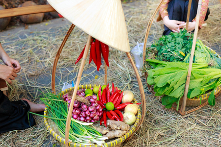 healthy foods: bamboo basket colorful spices and vegetables close up
