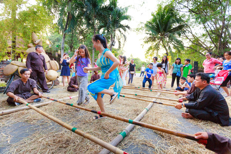bangles hand: Ho Chi Minh City, Vietnam - March 5, 2016: a bamboo dancing scene in the culinary fair at the Van Thanh tourist area, Ho Chi Minh City. Bamboo dancing is a form of community activities of the ancient Vietnamese