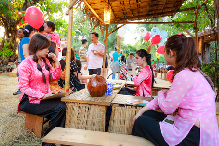 salesgirl: Hochiminh City, Vietnam - March 5, 2016: a sidewalk tea stall in the culinary fair of the Van Thanh tourist area Ho Chi Minh City which is modeled on the traditional market at the village Vietnam