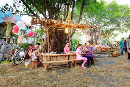 salesgirl: Hochiminh City, Vietnam - March 5, 2016: a fast-food stall in the culinary fair of the Van Thanh tourist area Ho Chi Minh City which is modeled on the traditional market at the village Vietnam