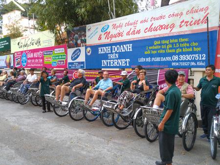 adult vietnam: Hochiminh City, Vietnam - February 26, 2016 :  Life in vietnam- Cyclo serve tourists in HoChiMinh City, Vietnam. Cyclo is the tourists farvourite vehicle transportation in vietnam