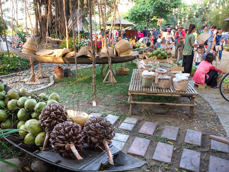 salesgirl: Hochiminh City, Vietnam - March 5, 2016 : bamboo basket full of traditional fruits the culinary fair at the Van Thanh tourist area, Ho Chi Minh City which is modeled on the traditional market in the village Vietnam