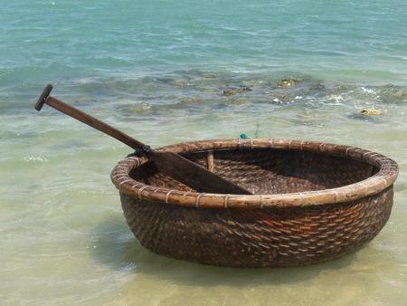 con dao: Vietnamese boat like basket near the ocean Stock Photo