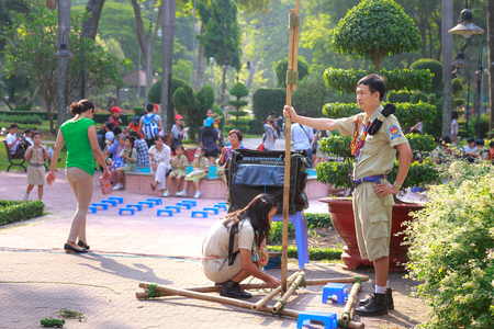 garb: Tao Dan park, Ho Chi Minh City, Vietnam - March 13, 2016 : the images of the scouts when they have outdoor activities  in a Tao Dan park in HoChiMinh city Editorial