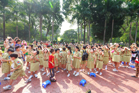 dreams of city: Tao Dan Park, Ho Chi Minh City, Vietnam - March 13, 2016: the images of the scouts when they have outdoor activities in a Tao Dan park in Hochiminh City . They released the balloons into the sky carrying the letters, in which there are dreams of their fut Editorial