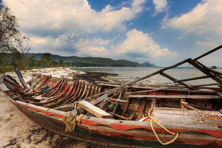 deteriorate: abandoned old boat view beside the beach
