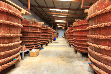 forage fish: Phu Quoc island, Kien Giang province, Vietnam - May 02, 2016 : at factory fish sauce production facilities on Phu Quoc island by traditional fermented method of anchovies fermented brewed in large wooden barrels. to gain the pure fish sauce. This produtio
