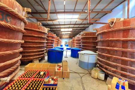 checking ingredients: Phu Quoc island, Kien Giang province, Vietnam - May 02, 2016 : at factory fish sauce production facilities on Phu Quoc island by traditional fermented method of anchovies fermented brewed in large wooden barrels. to gain the pure fish sauce. This produtio