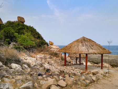 idling: Parasols at a Hang Rai beach of Ninh Thuan province, VietNam
