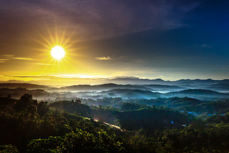 the sunrays on the rows of mountains and forests were covered by fog at dawn on Lam Vien Plateau, Lam Dong Province