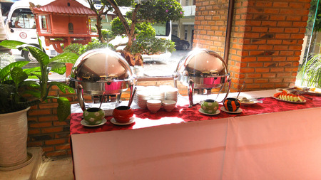 hotel staff: Da Lat city, Vietnam - July 03, 2016: the staff of a hotel in the city of Dalat is preparing breakfast buffet for its guests Editorial
