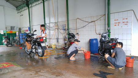 overcrowded: Ho Chi Minh city, Vietnam - June 28, 2016: At a motocycle  wash machine service. This service is thriving business here, perhaps because of motorbikes in Ho Chi Minh City are overcrowded