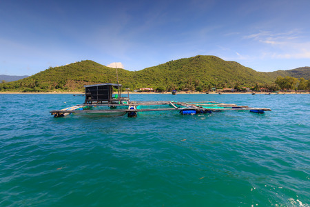 Cage aquaculture farming on sea of  fishermens at island Diep Son, Vietnam Stock Photo