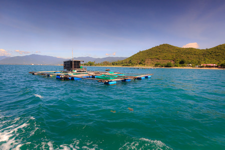 fishermen's: Cage aquaculture farming on sea of  fishermens at island Diep Son, Vietnam Stock Photo