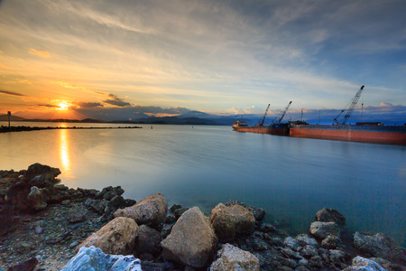 Sunset on a sea port in the coastal city of Nha Trang, Vietnam