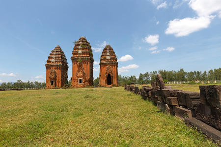 Binh Dinh Province, Vietnam - August 28, 2016: towers Champa is built from the late 7th century to the early 17th century. Image of three towers Duong Long towers Cham ruins on a high mound venture Tay Son District, Binh Dinh Province.