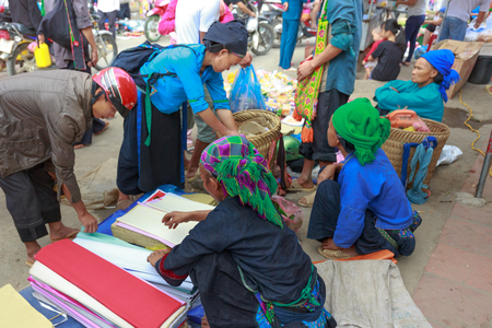 ha giang: Hoang Su Phi, Ha Giang province, Vietnam - October 2, 2016: ethnic minority people set out the agricultural products homemade by themselves at the Sunday fair in Hoang Su Phi. they selling and exchanging homemade products such as : wine, knife, textiles,
