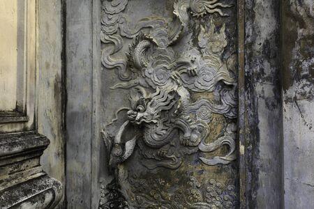 Ha Noi, Viet Nam - October 5, 2016 : Details of sculptures on wall  in Temple of Literature, this is the first university of Vietnam. Van Mieu is symbol of Hanoi - Vietnam
