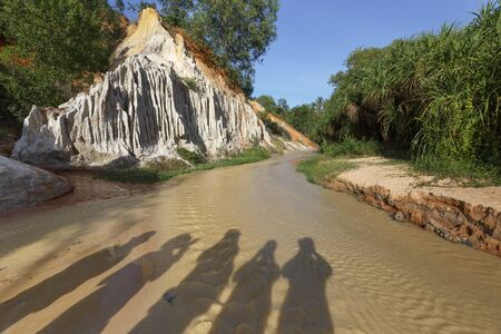 oxides: shadows of the tourists on the Red Stream in Binh Thuan Province, Vietnam