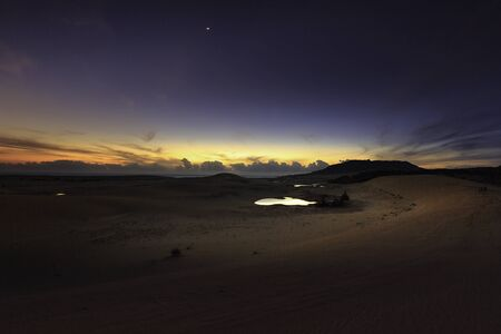 sand dunes and lakes when dawn rising at Mui Dinh, Ninh Thuan Province, Vietnam Stock Photo