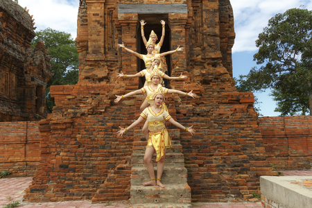 Phan Rang town, Ninh Thuan province, Vietnam - November 27, 2016 : The Cham girls perform a Cham tradition dance at ancient Po Klong Garai temple, Phan Rang town, Ninh Thuan province, Vietnam Editorial