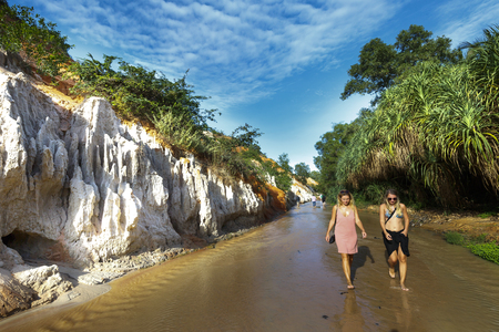 Mui Ne, Phan Thiet city, Vietnam - November 27, 2016 : tourists so excited to be walking on feet in the Red Stream ( it also named Fairy Stream) located near the beach of Mui Ne, Binh Thuan Province, Vietnam