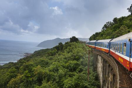 Da Nang city, Viet Nam - October 26, 2016: picture a train running through Hai Van Pass in the middle center of Vietnam. Editoriali