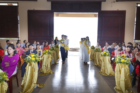 commit: Truc Lam zen monastery in Vinh Phuc Province, Vietnam - October 19, 2016 : Image of the Buddish monks are making constant feast upon for young couple at Truc Lam zen monastery in Vinh Phuc Province, Vietnam