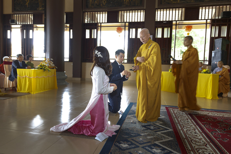 Truc Lam zen monastery in Vinh Phuc Province, Vietnam - October 19, 2016 : Image of the Buddish monks are making constant feast upon for young couple at Truc Lam zen monastery in Vinh Phuc Province, Vietnam