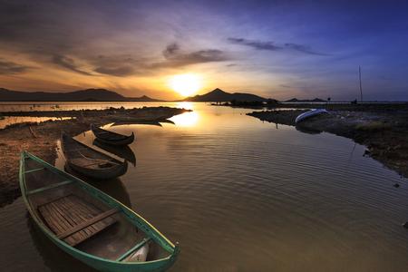 small fishing boats on the beach at dawn in Phan Rang city, Vietnam Stock Photo