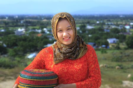 Phan Rang city, Viet Nam - December 24, 2016 : Beautiful portrait of Cham girl, minority ethnic of Vietnamese, pretty women in traditional dress on the sand dunes