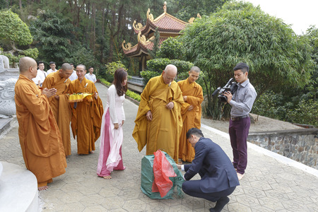 the abbot: Truc Lam zen monastery in Vinh Phuc, Vietnam - October 19, 2016: A image of a newlyweds after their ceremony, they are releasing birds to nature at Truc Lam Zen Monastery in Vinh Phuc