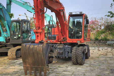 Binh Phuoc province, Viet Nam - March 5, 2017: Excavator of a new rubber plantation farm bought for the new crop.