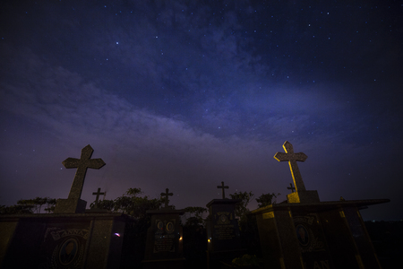 loc: Cemetery at Bao Loc Town, Lam Dong Province, Vietnam - March 25, 2017: Cemetery with many tombs under the twinkle stars sky in night