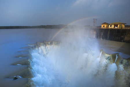 water flow to spillway on station dam, irrigation. Irrigation dams are draining water for irrigation system. This is Phuoc Hoa dam in Binh Duong province, Viet Nam