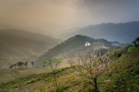 The beautiful fanciful landscape of high mountains and mist in the sunset in Ha Giang, Viet Nam