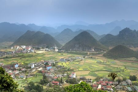 Fairy bosom is located in Tam Son town, Quan Ba District, Ha Giang Province, Vietnam. The colorful the mixture of paddy fields and house roofs. Twin mountain, double mountain