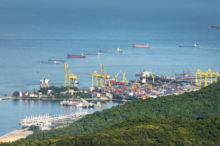 Harbor Tien Sa, Da Nang, Vietnam - July 2, 2018: panoramic Harbor Tien Sa view from the top of the Son Tra Peninsula. Tien Sa Harbor with many cargo containers lined on board prepared for export Editorial