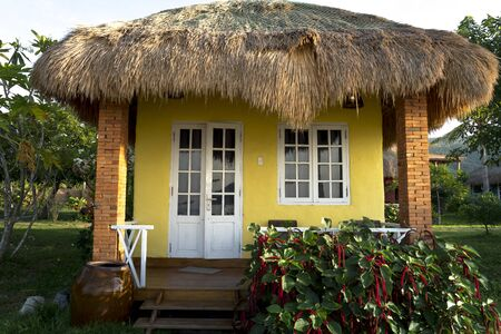 Ninh Van Commune, Khanh Hoa Province, Vietnam - June 26, 2018: The colorful bungalows with decorative walls in form of Vietnamese rural style in Backpacker Hostel in Ninh Van commune, Khanh Hoa province, Vietnam