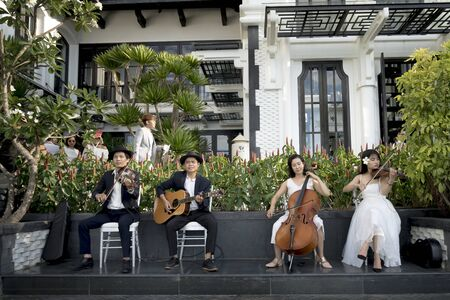 Intercontinental Peninsula Resort Da Nang, Vietnam -July 8, 2018: A band playing in the wedding at a luxury resort Intercontinental Peninsula Resort Da Nang, Vietnam Editorial
