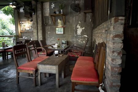 Ha Noi Old Quarter, Hanoi capital, Vietnam - July 16, 2018:  A coffee shop decorated in the style of war in the ancient streets of Hanoi. Customers come here for coffee and remember the past of the war Stock Photo - 128537797