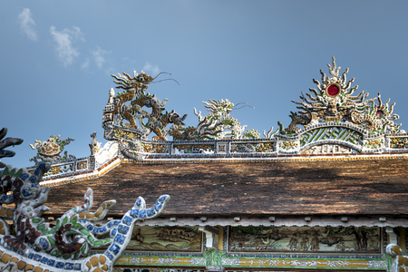 Vietnamese decoration on ancient temples roof. The dragon statue on the ancient temple roof symbolized the strength and power of the kings in feudal Vietnam