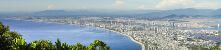 panoramic Da Nang city view from the top of the Son Tra Peninsula. Da Nang is a coastal city in central Vietnam known for its sandy beaches and history. It's the fourth largest city of Vietnam