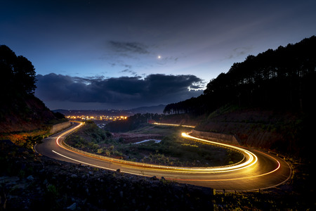 image of the road on the pass in the night, Da Lat city, Vietnam. The road is very quiet and the weather is beautiful Stock Photo