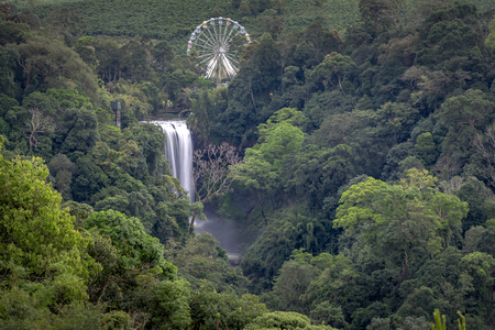 Pictures of a beautiful natural waterfall next to the giant ferris wheel in the eco-tourism area in Bao Loc in Lam Dong Province, Vietnam.