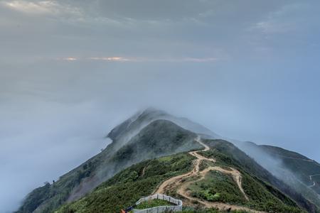Beautiful landscape with fog and mountain in Ta Xua, Son La, Vietnam