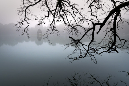 Hoan Kiem Lake ( Ho Guom) in the center of Hanoi in the fog in the morning. Hoan Kiem Lake is a famous tourist place in Hanoi 스톡 콘텐츠