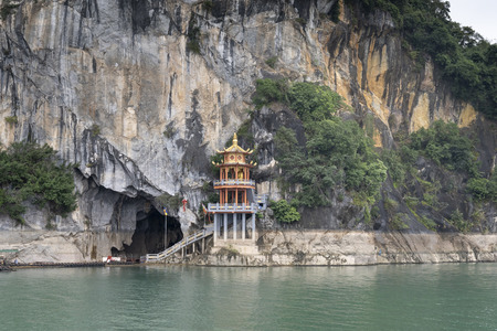 Thac Bo Cave, Thung Nai Commune, Cao Phong District, Hoa Binh Province, Vietnam - January 9, 2019: A temple is located at the main entrance to Thac Bo Cave on Hoa Binh Lake. This is a famous tourist destination in northern Vietnam