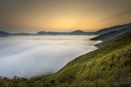 Magical sunset landscape with the cloudy sea in valley and mountain in Ta Xua, Son La, Vietnam 스톡 콘텐츠