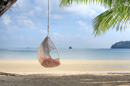 The swing on the sandy beach on paradise island Villa Koh Rong Samloem. This is a small island that attracts many visitors from all over the world because of its beauty. It is located in the Gulf of T